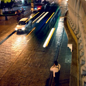A bus blasts down Calle 60 beneath the balcony of the Bella Epoca restaurant. Anyone who has walked the streets of Merida does not soon forget the traffic. <a href=></a>