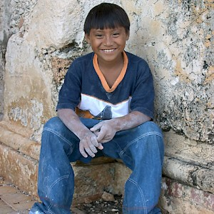 A young resident of Chunchucmil has just finished laying chalk lines for the campo de futbol (soccer field) and is taking a brief rest before the big game. <a href=></a>
