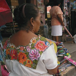 Called a huipil, the traditional dress of the Mayan women display intricate embroidery that identifies their region and history. <a href=></a>