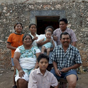 A family of Mayans who live in Oxtapacab, Yucatan. There are three generations living in their thatched home. <a href=></a>