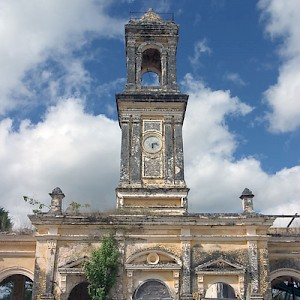 One of the more graceful and haunting haciendas is Uayalceh (pronounced why-al-kay), now abandoned. The clock tower shown here crowns the casa de maquinas. <a href=></a>