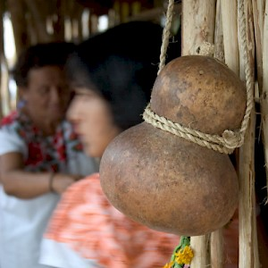 This traditional gourd hangs at the entrance to a Mayan hut erected in the Plaza Grande. <a href=></a>