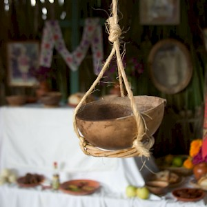 Gourds are used for many things. This one hangs in front of a Hanal Pixán altar... but has nothing in it! <a href=></a>
