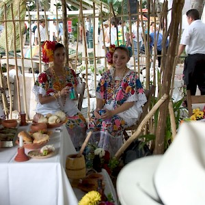 Two lovely ladies wearing the formal version of the traditional Mayan huipile. <a href=></a>