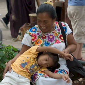 A Mayan woman and her daughter playing in the park. <a href=></a>