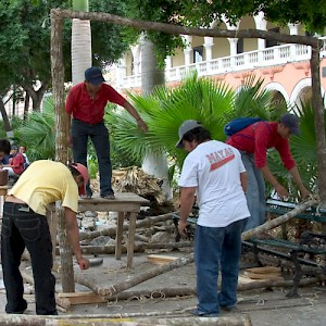 Men from a village tearing down an altar in Merida&#039;s Plaza Grande to take it home. <a href=></a>