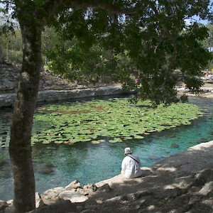 Relaxing at the cenote near the Mayan Archaeological Site of Dzibilchaltun. <a href=></a>