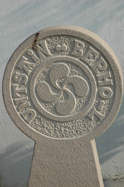 A stele from a Basque cemetery, with Basque writing and the lauburu. <a href=></a>