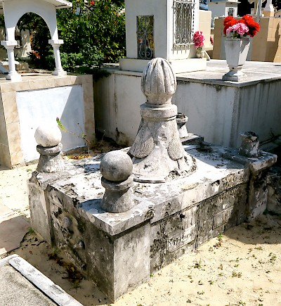 The empty grave of Fermin Antonio Mundaca y Marecheaga in the Isla Mujeres Cemetery. He is given credit for carving the skull and crossbones. <a href=></a>