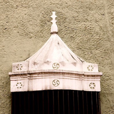 Basque lauburu on a colonial home window decoration in Valladolid. <a href=></a>