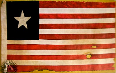 Replica of the official flag of the Navy of the Republic of Texas that was raised over Cozumel as the Texans claimed the island for their new republic. <a href=></a>