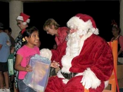 Chelem children enjoying a visit from Santa Claus in Yucatan <a href=></a>