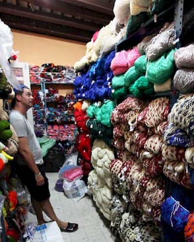 Constantino taking hammock inventory in Merida, Yucatan at Hammock Boutique <a href=></a>